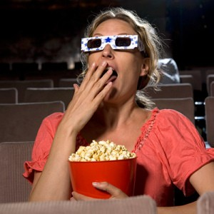 Woman-eating-popcorn-at-movies